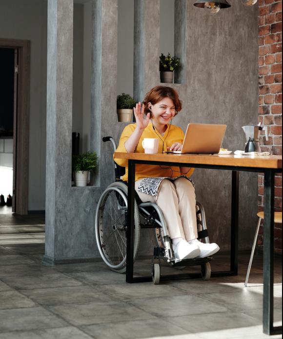 woman-in-orange-tank-top-sitting-on-black-wheelchair-4064696 1